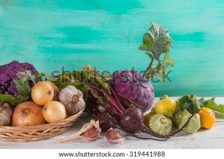 Different fresh vegetables on wooden table, selective focus - stock photo