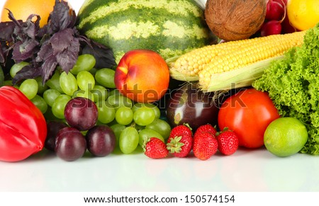 Different fruits and vegetables on white background - stock photo