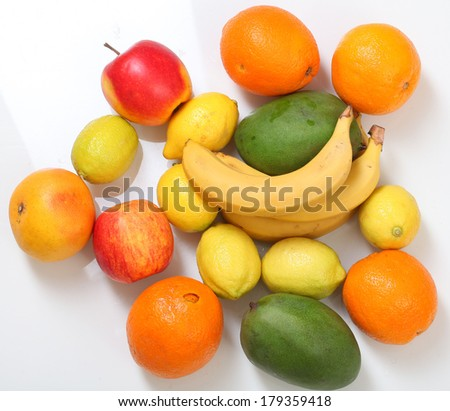 Different fruits on white background