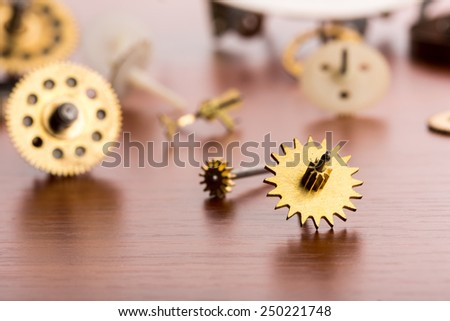 Different gears on the table closeup - stock photo