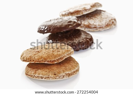 Different ginger breads with icing and chocolate icing - stock photo