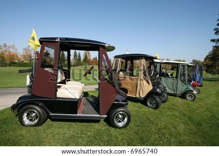 different golf carts on golf course
