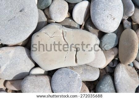 Different gray stones pebble beach. Selective focus. - stock photo