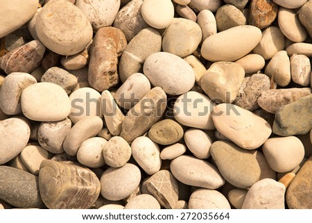 Different gray stones pebble beach. Toned. Selective focus. - stock photo