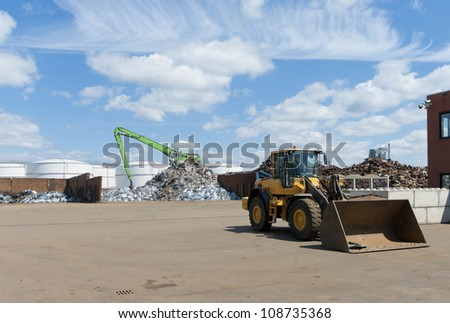 different heaps of metal recycled from car wrecks - stock photo