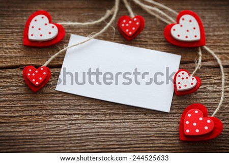 different  hearts hanging in front of wooden board for valentines day
