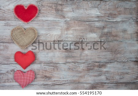 Different hearts made of cloth on a wooden table. Love and Valentine's Day