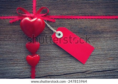 different  hearts on a wooden board for valentines day - stock photo