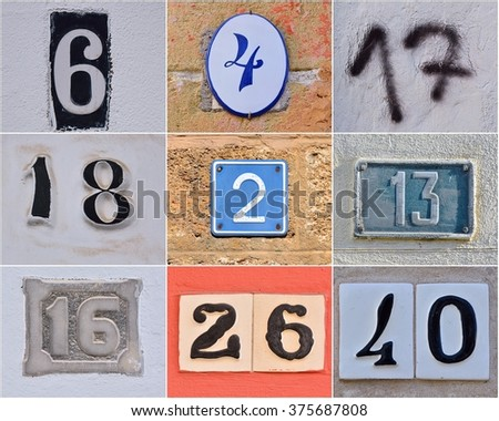 Different house numbers on walls
