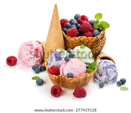 Different ice cream and berries in a wafer cones and bowl isolated on white background - stock photo