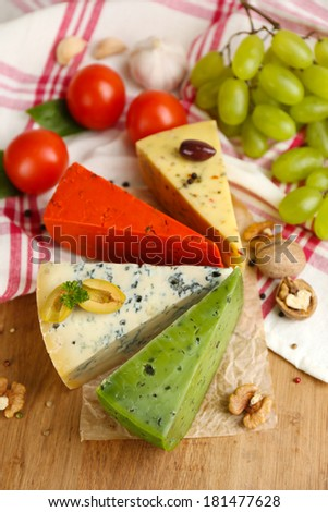 Different Italian cheese on wooden table - stock photo