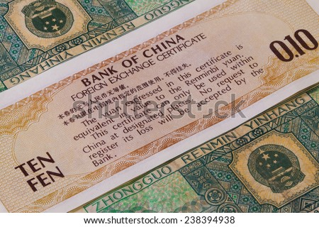 Different Juan banknotes from China on the table - stock photo
