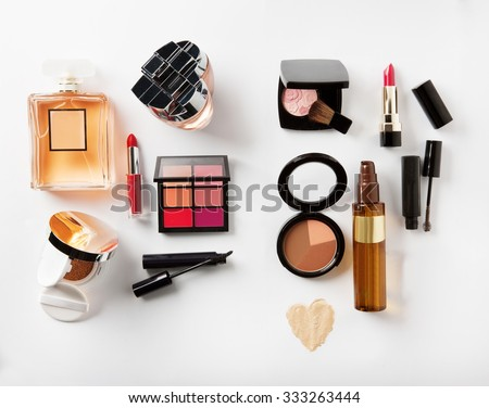 different kind of cosmetics on a plan isolated with shadows - stock photo
