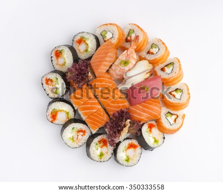Different kind of rolls and sushi isolated over white background. top view. - stock photo