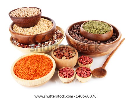 Different kinds of beans in bowls isolated on white - stock photo