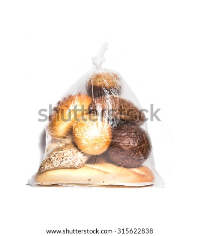 Different kinds of bread in transparent bag isolated on white - stock photo