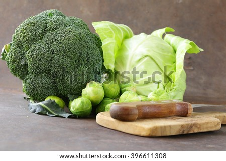 different kinds of cabbage - broccoli, Brussels sprouts and white cabbage - stock photo