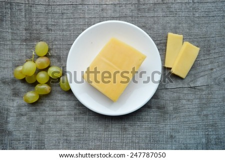 different kinds of cheese with walnuts and grapes - stock photo