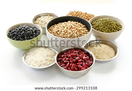 Different kinds of Grains, five grains are on white background. - stock photo