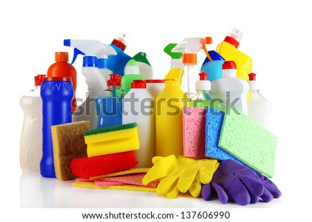 Different kinds of house cleaners and colorful sponges, gloves isolated on white