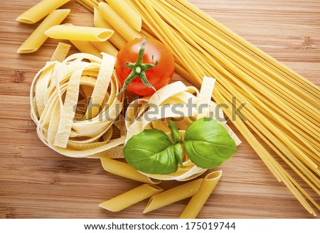 different kinds of pasta (spaghetti, fusilli, penne, linguine) - stock photo