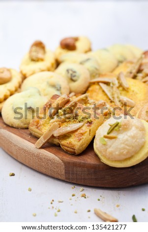 Different kinds of Persian cookies on wooden board. Also available in horizontal format. Close up.
