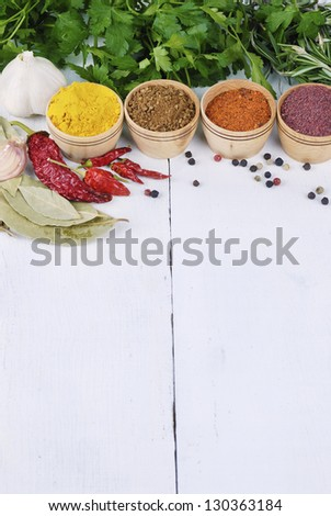 Different kinds of seasonings and herbs on the white oak table