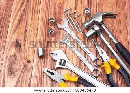 Different kinds of tools on wooden  background - stock photo