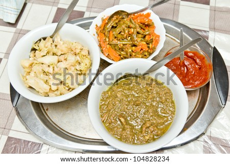 Different kinds of traditinal Ethiopian wot (stew) served in a bowl. - stock photo