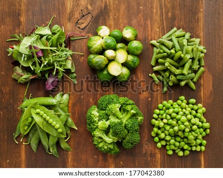 Different kinds of vegetables on the wooden background. Viewed from above. - stock photo