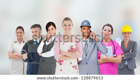 Different kinds of workers on grey blurred background