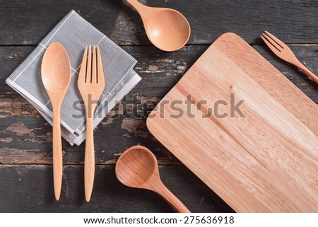 different kitchen wooden utensils on old grunge table  - stock photo