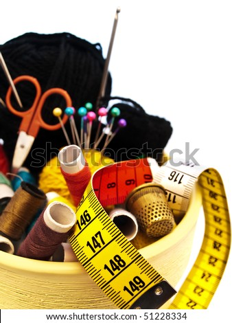 different knitting items in the pot over the white background - stock photo