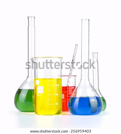 Different laboratory glassware with colored liquid isolated over white background.