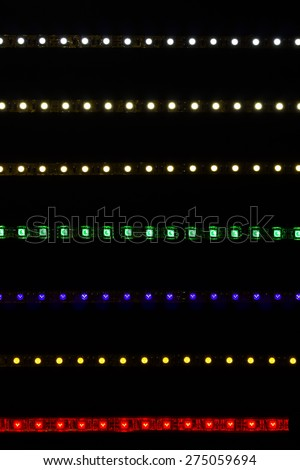 Different LED strips on black background, glowing LED garland - stock photo