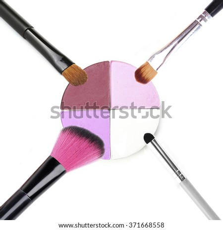 Different makeup brushes isolated on white - stock photo