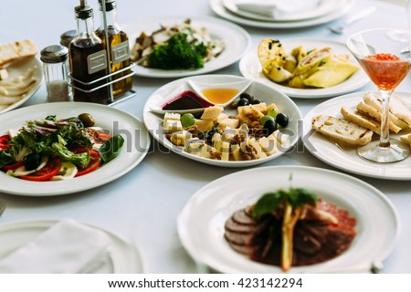 Different meals for the guests on the wedding table - stock photo