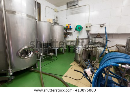 Different mechanisms for filling various containers with olive oil at factory