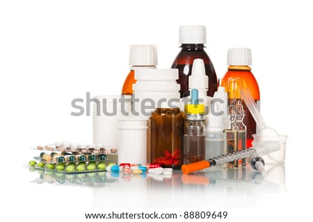 Different medical bottles and tablets isolated on white