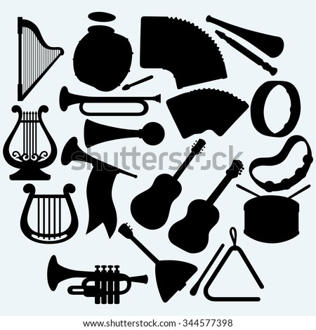 Different music instruments. Isolated on blue background. Raster silhouettes