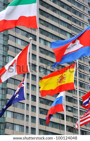 Different national flag on building background - stock photo
