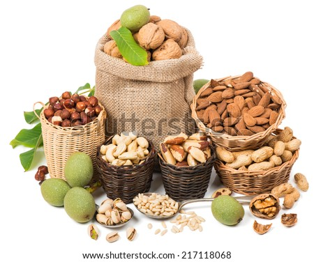 Different nuts in a baskets isolated on white background  - stock photo