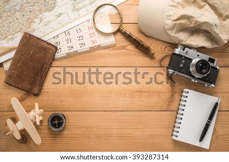 Different objects for traveling on wooden background