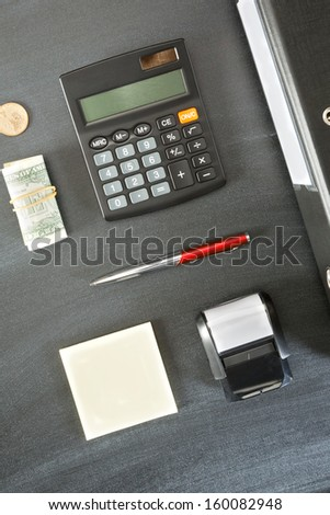 Different office-related objects nicely arranged over a blackboard and photographed from above. - stock photo