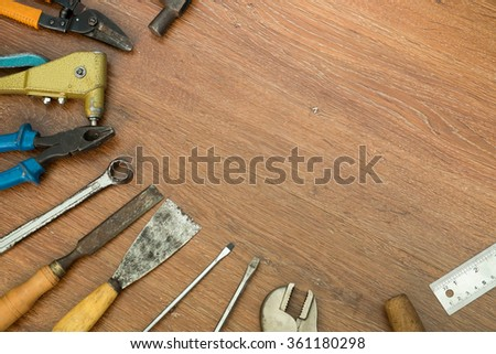 different old tools with blank  on wood , tools concept - stock photo