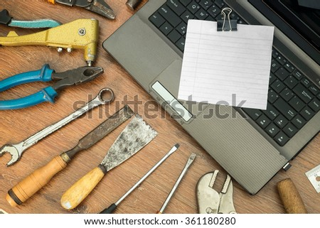 different old tools with blank paper on wood,technology tools concept - stock photo