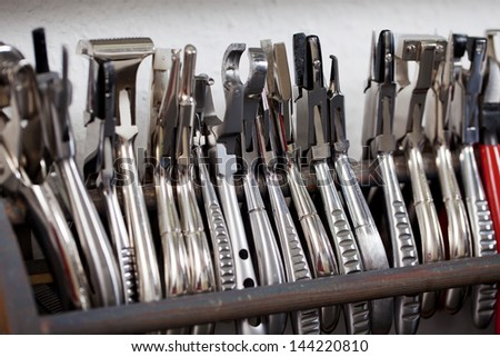 different optician��?���´s tools standing in a row at the workbench - stock photo