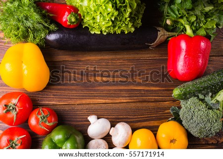 Different organic vegetables on a wooden background. Healthy eating