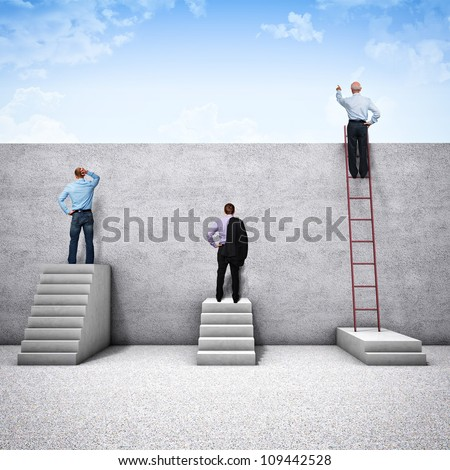 different people try to see behind the wall - stock photo