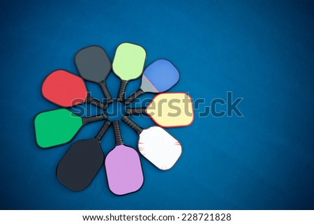 Different Pickleball paddles on the court - stock photo